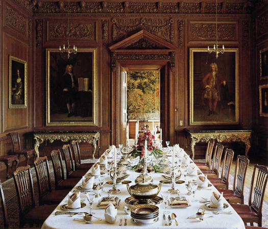 The dining room, my favorite room, in part because it is so tastefully decorated, and not overly ornate. The wainscoting on the oak-panelled walls is finely carved.