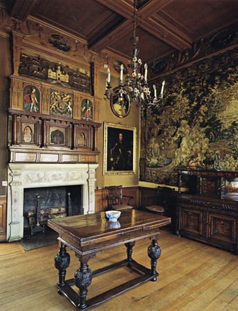The stag parlor for the man of the house, redecorated in the early 19th century. Above the fireplace is a a rendition of the 17th century Lyme Park; below, is a frieze portraying the life of a stage. Several of the famous Cadmus tapestries are here.